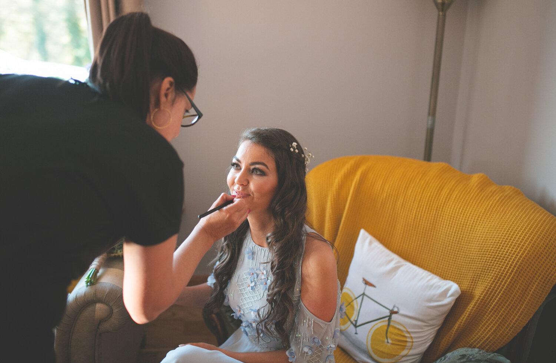 Bride having makeup put on
