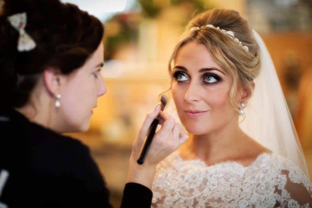 make up being put on bride